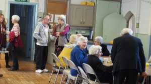 People from the local area enjoying activities in the community centre