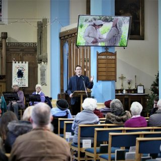 Ben preaching to the congregation at St Saviour's Retford
